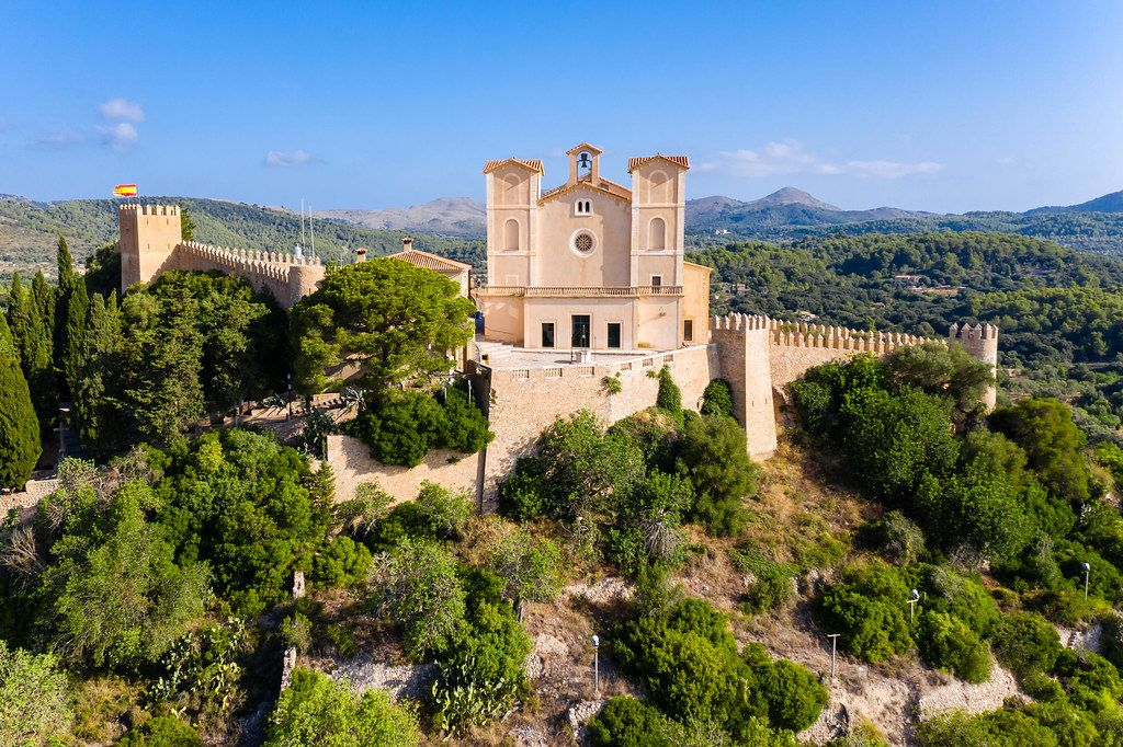Front view from the air of the Sant Salvador sanctuary and fortress on the hill in Artà, Mallorca