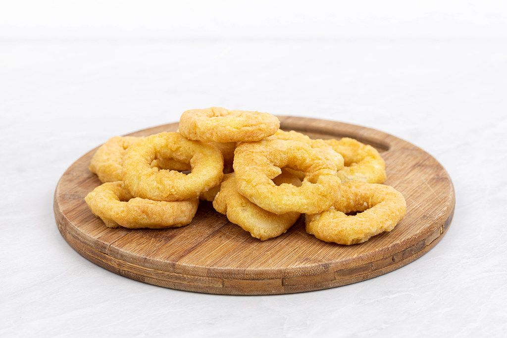 Frozen Fish Rings on the wooden board
