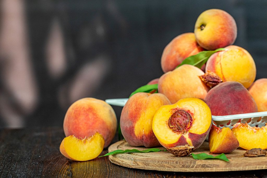 Fruit background with fresh ripe peaches