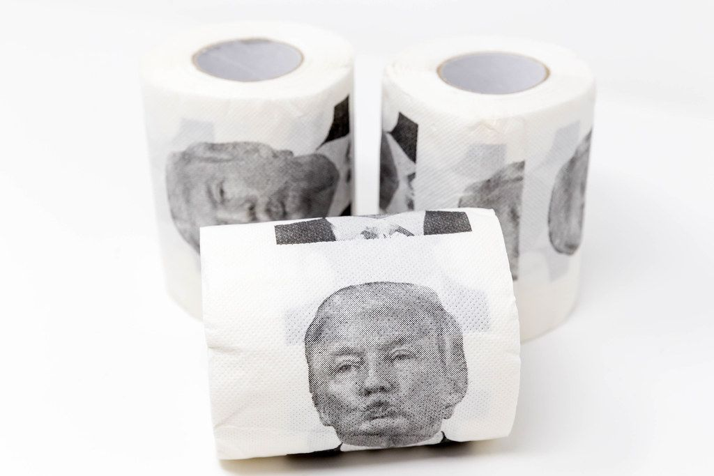 Fun with politics: three rolls of toilet paper with a print of Donald Trump