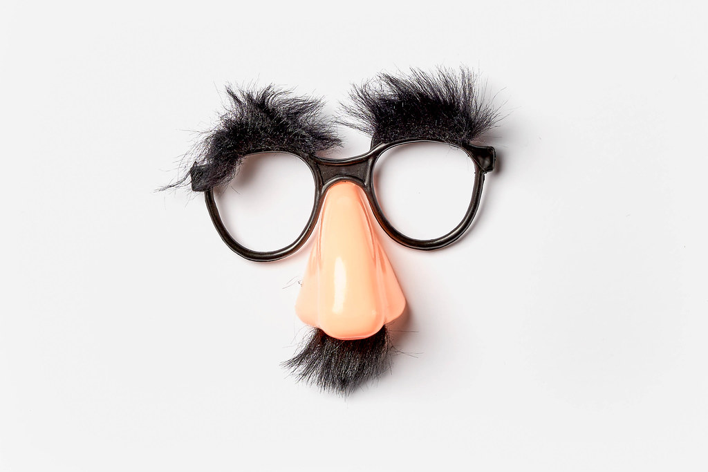 Funny face mask on white background