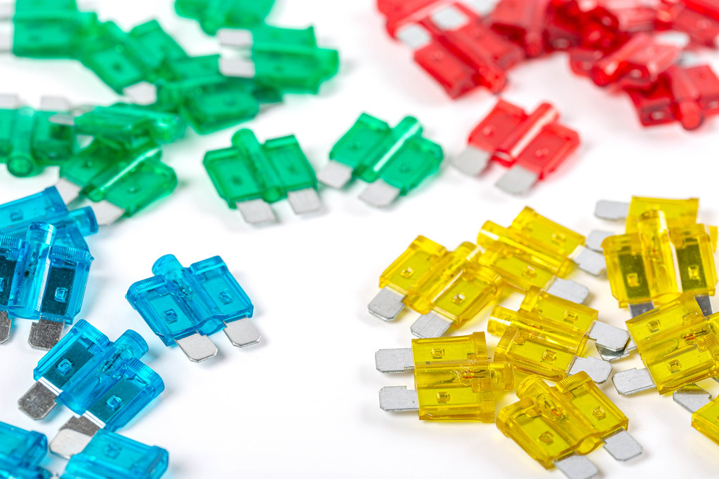 Fuses of different colors on a white background
