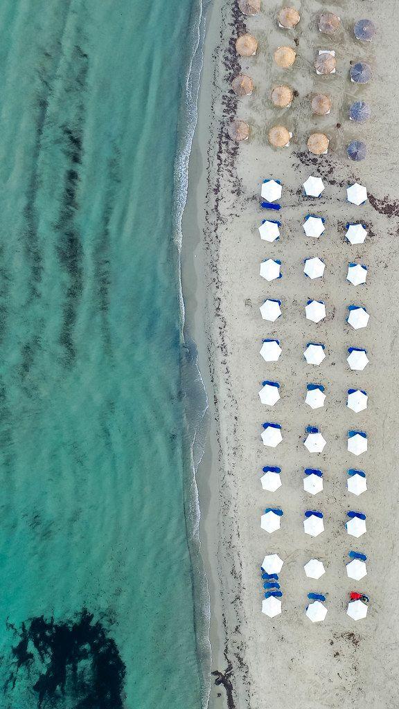 Geometric beach design: overhead drone shot at Agios Georgios (St. George) on Greek island Naxos