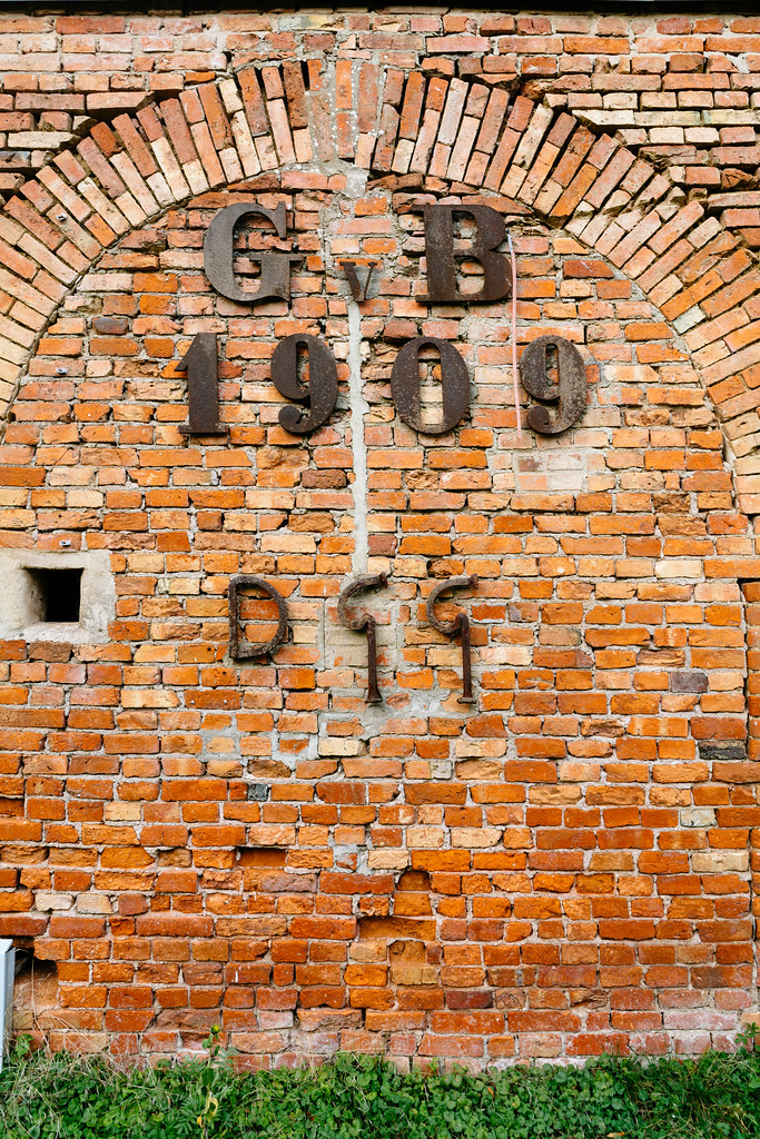 German GvB metal logo on a yellow brick wall