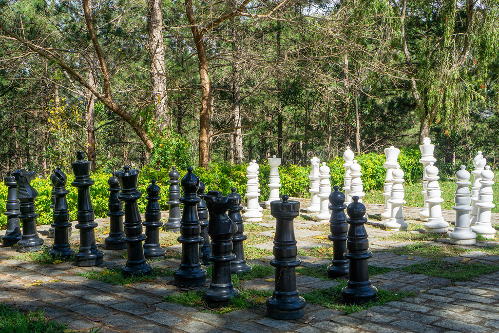 Giant Outdoor Chess Board with Human Size Chess Pieces in the Park of Bao Dai King Palace in Da Lat, Vietnam