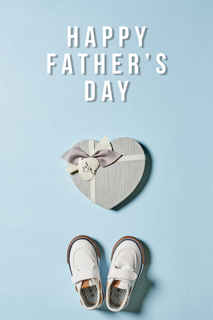 Gift box, baby's shoes and greeting text - Happy father's day