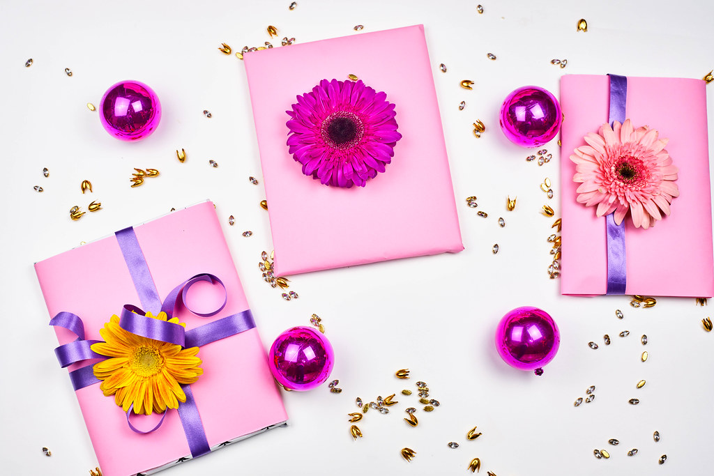 Gifts and flowers on white