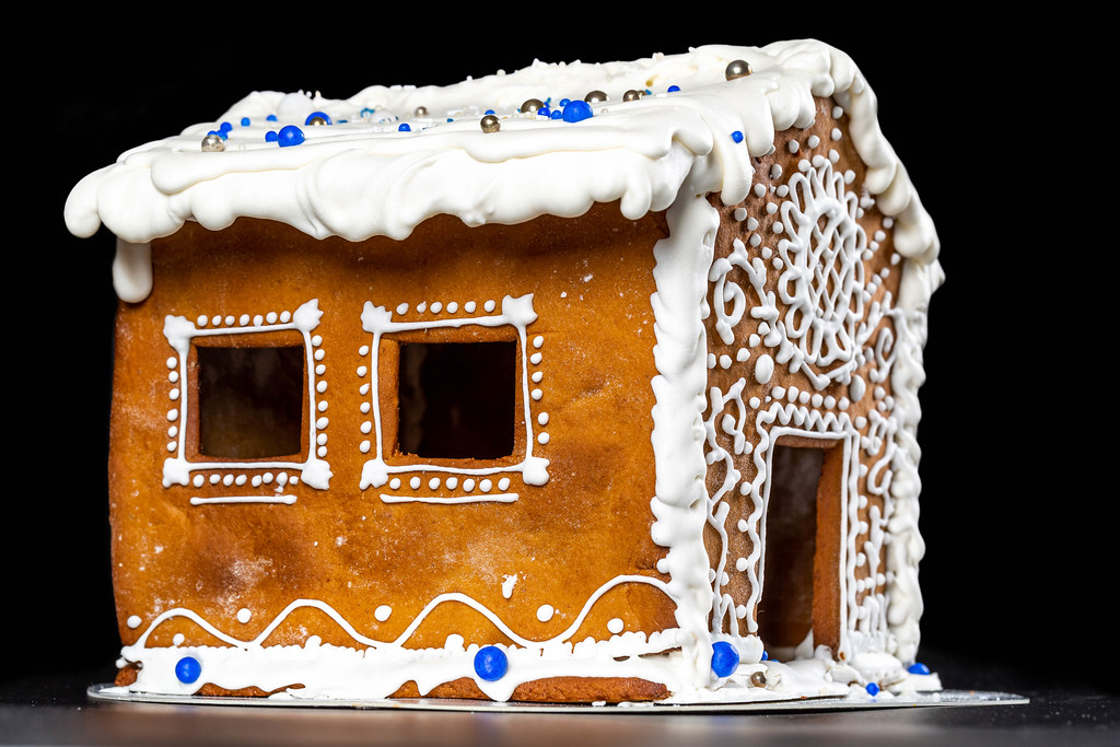 Gingerbread house with winter icing patterns on a dark background