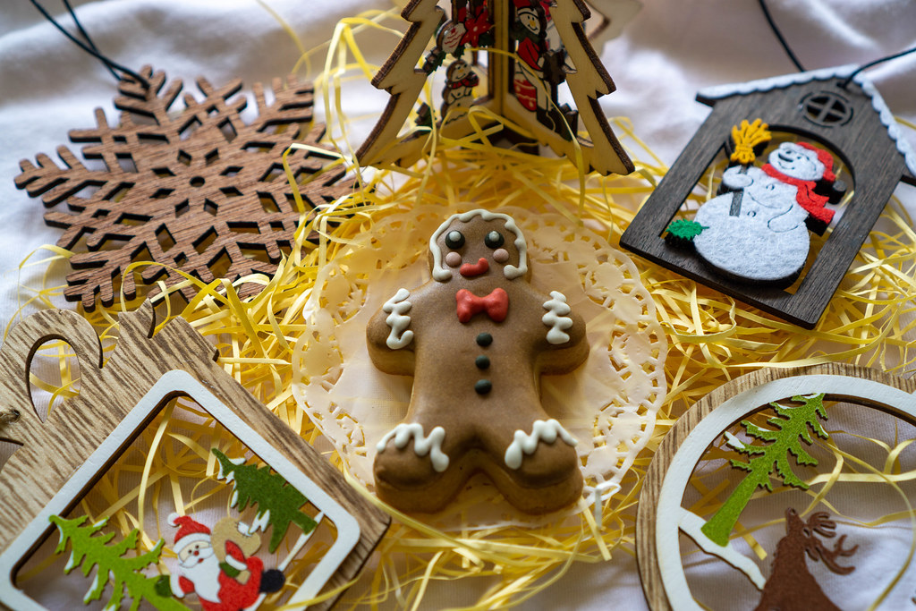 Gingerbread Man Christmas Cookie with Different Wooden Christmas Decorations such as Christmas Tree, Snowflake, Santa Claus and Snowman