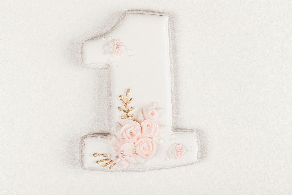 Gingerbread number one on a white background. Birthday cookies