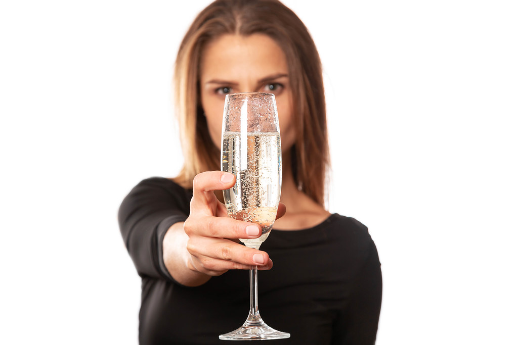 Glass of champagne in a woman's hand, close-up