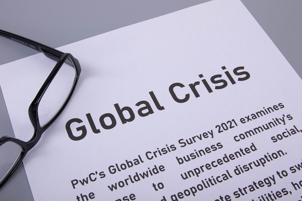 Glasses and article about global crisis