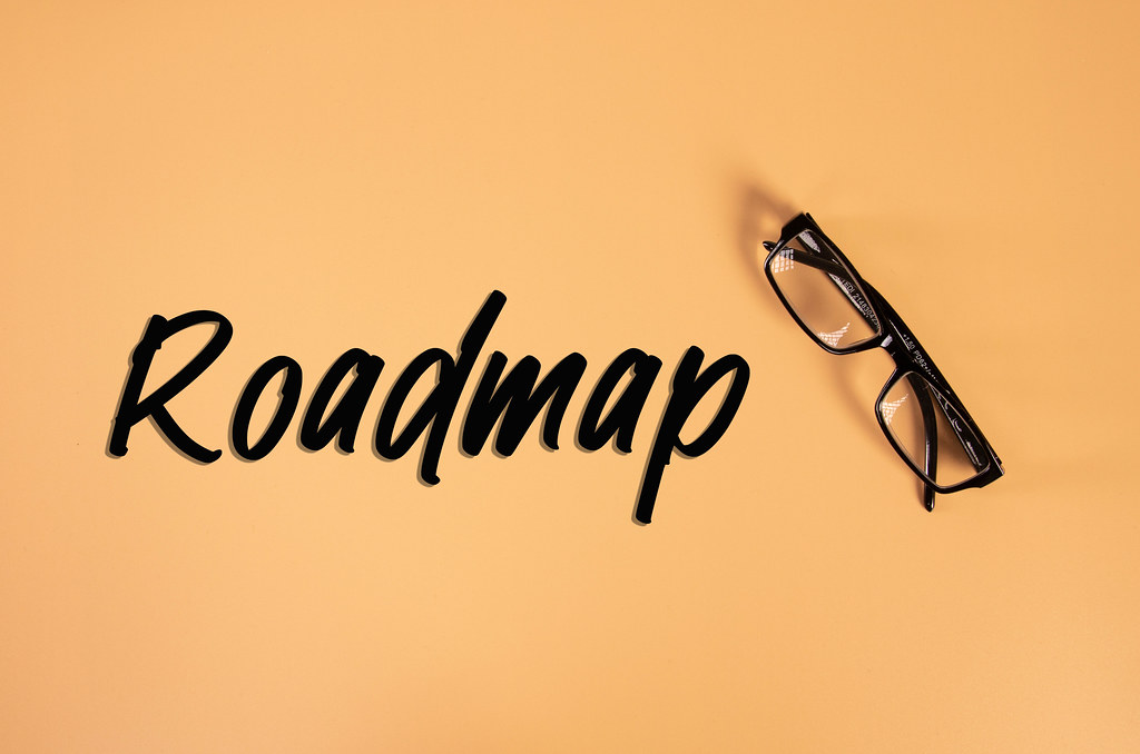 Glasses with Roadmap text on orange background