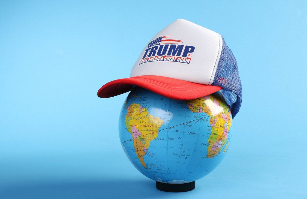 Globe wearing a Trump trucker hat