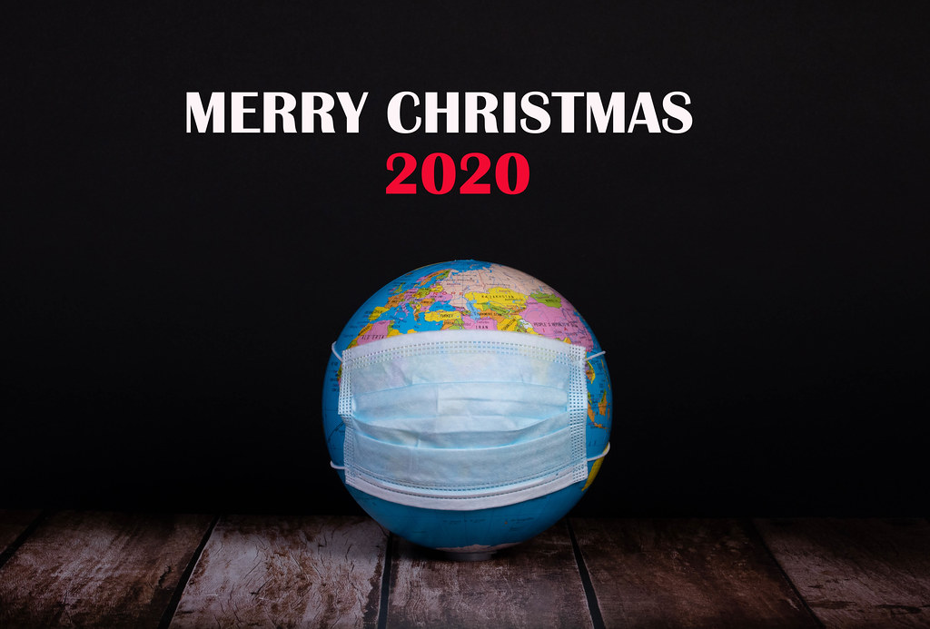 Globe with face mask and Merry Christmas 2020 text