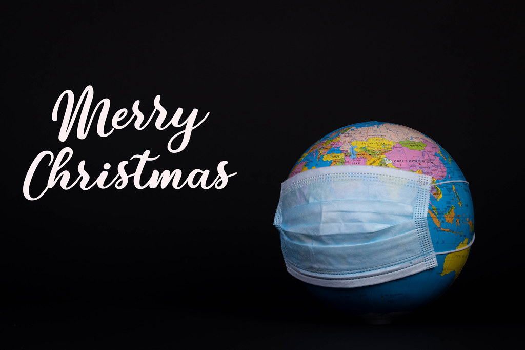 Globe with face mask and Merry Christmas text