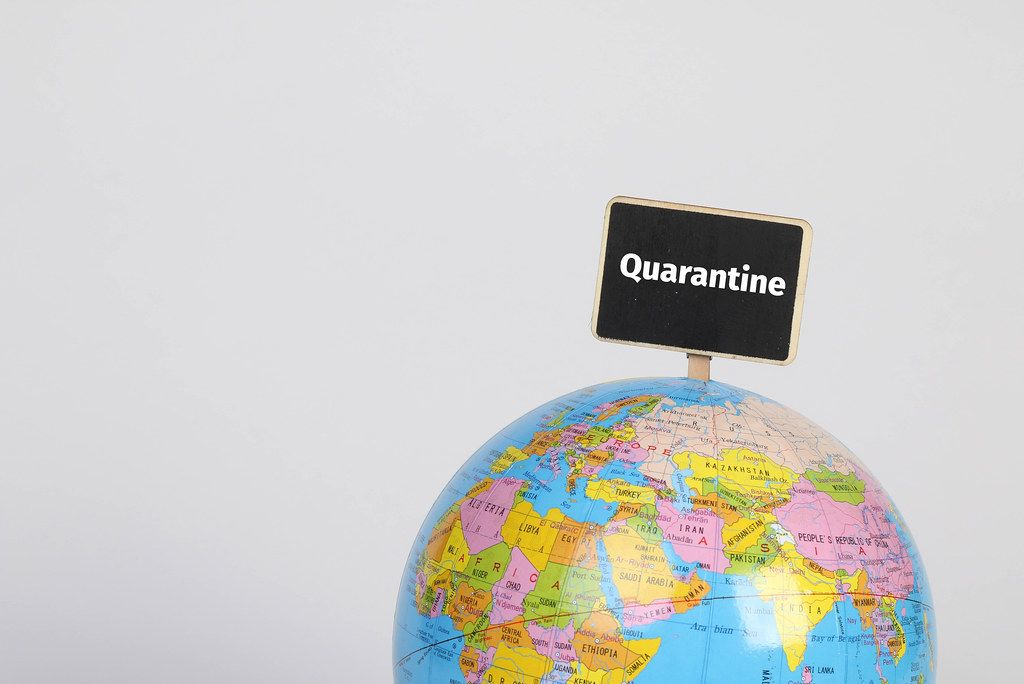 Globe with Quarantine sign
