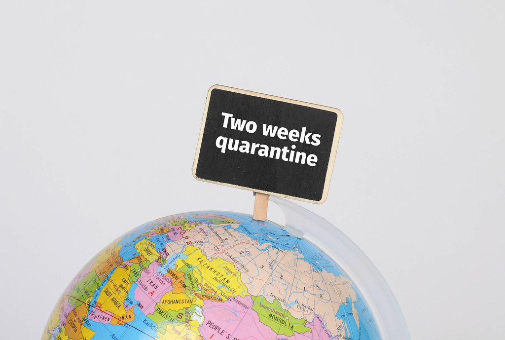 Globe with Two weeks quarantine sign