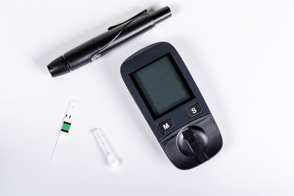 Glucometer set on a white background. Rapid blood glucose test device
