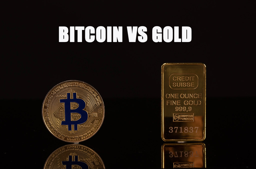 Golden Bitcoin and gold bar with Bitcoin vs Gold text on black background