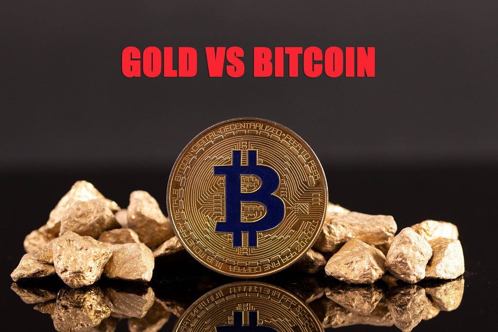 Golden Bitcoin and gold nuggets with Gold vs Bitcoin text