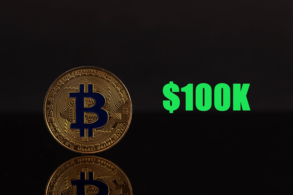 Golden Bitcoin with 100k text on black background