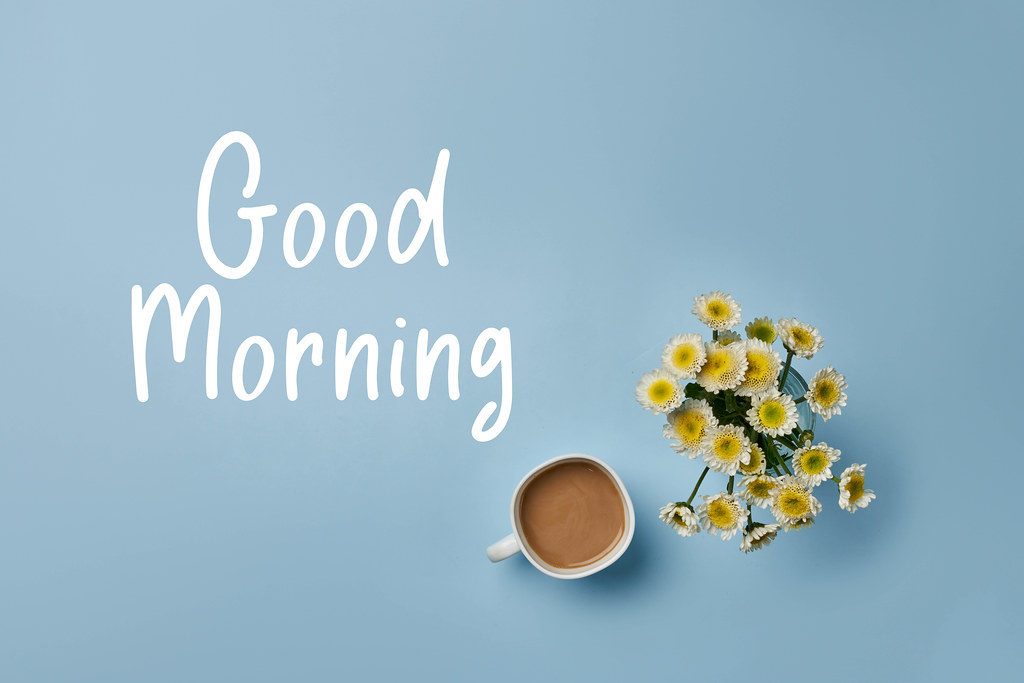 Good morning concept with cup of coffee and flowers