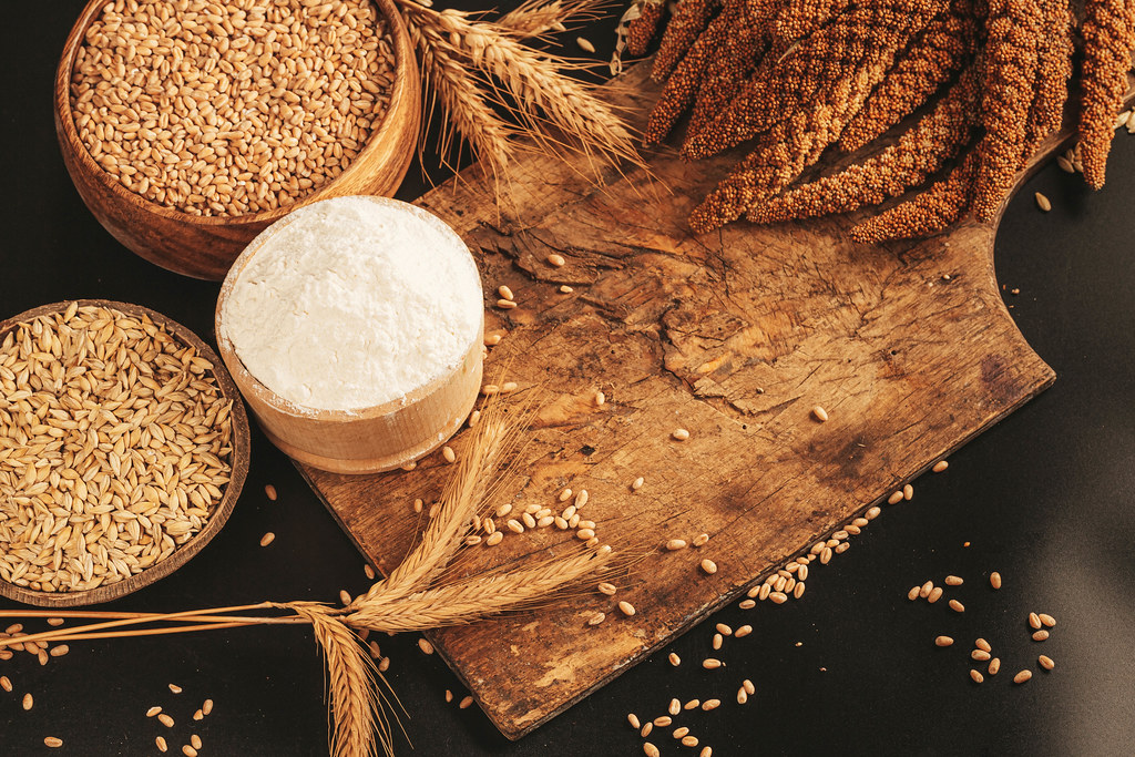 Grains and spikelets of millet, wheat, barley and wheat flour