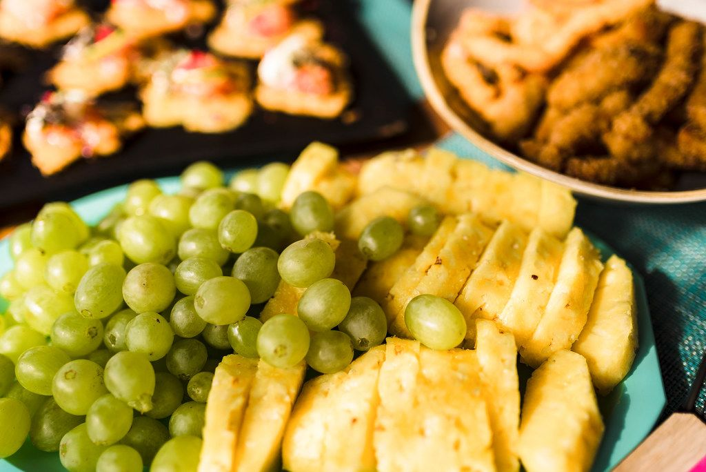 Grapes And Pineapple On Blue Dish