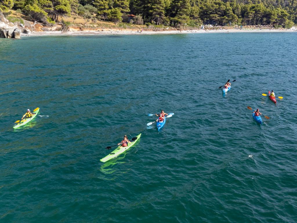 Greece holidays in summer 2021: tourists on six kayaks at Kastani Beach, Skopelos