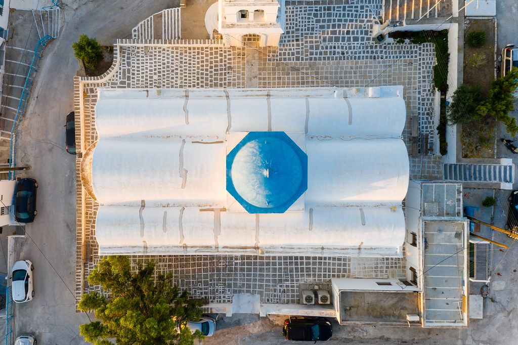 Greek architecture seen from the air: the white church of Agios Charalambos with the blue dome