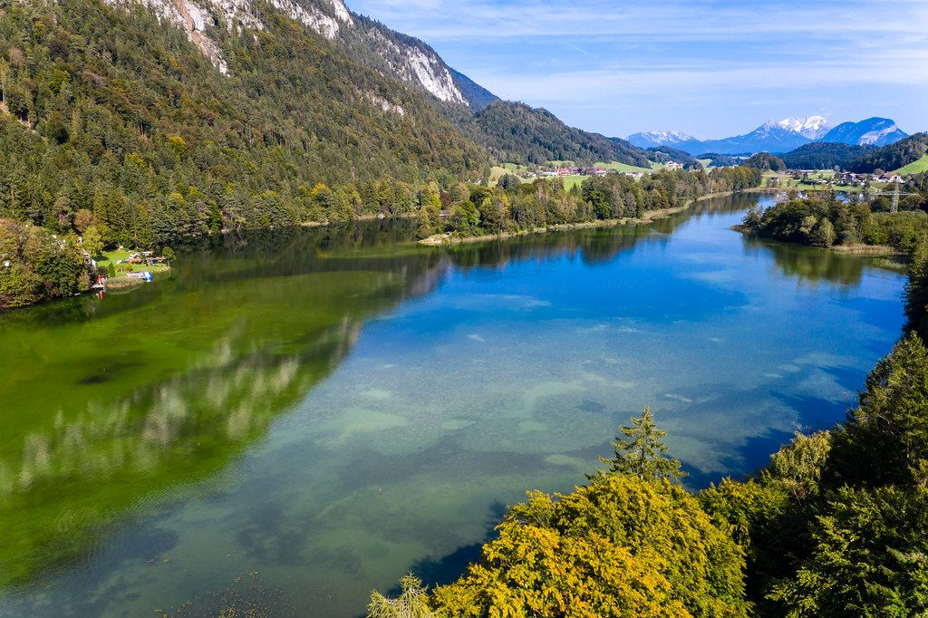 Green-blue waters and trees with red-yellow leaves. Autumn aerial view of lake Reintal in Austria