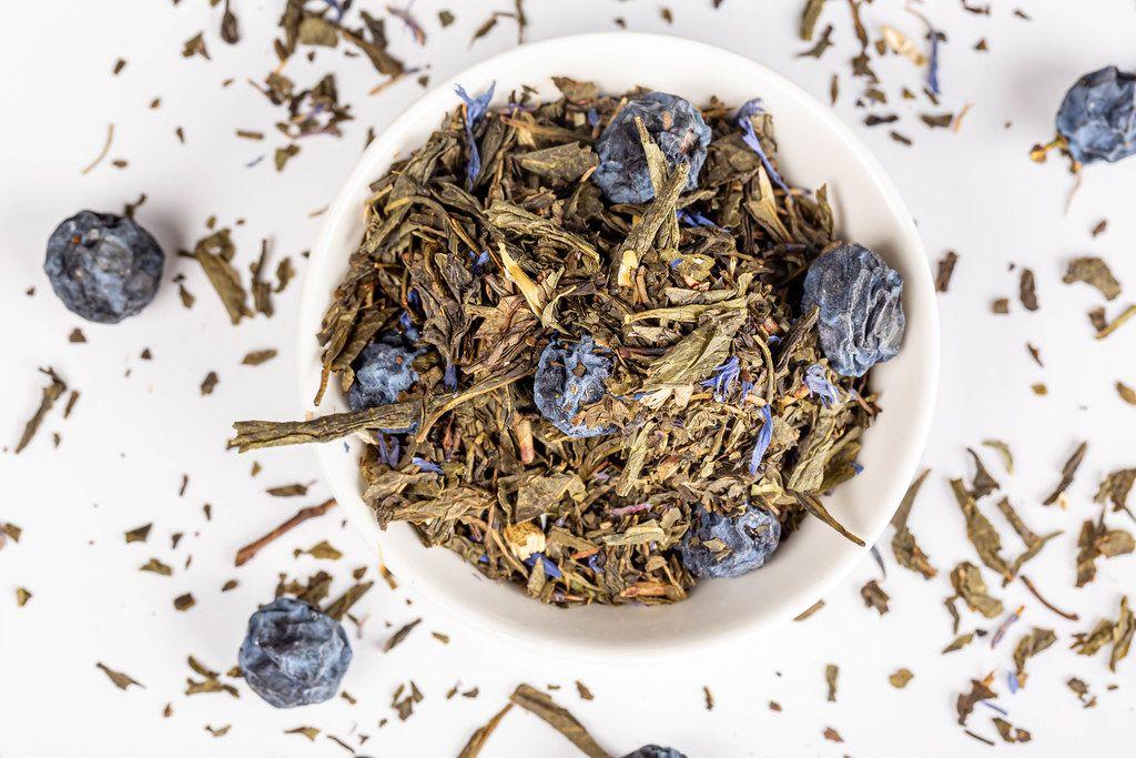Green herbal tea with dried blackthorn berries