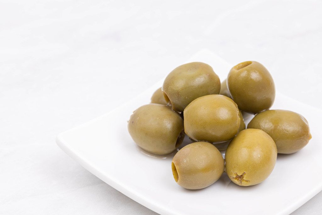 Green Olives served on the plate with copy space