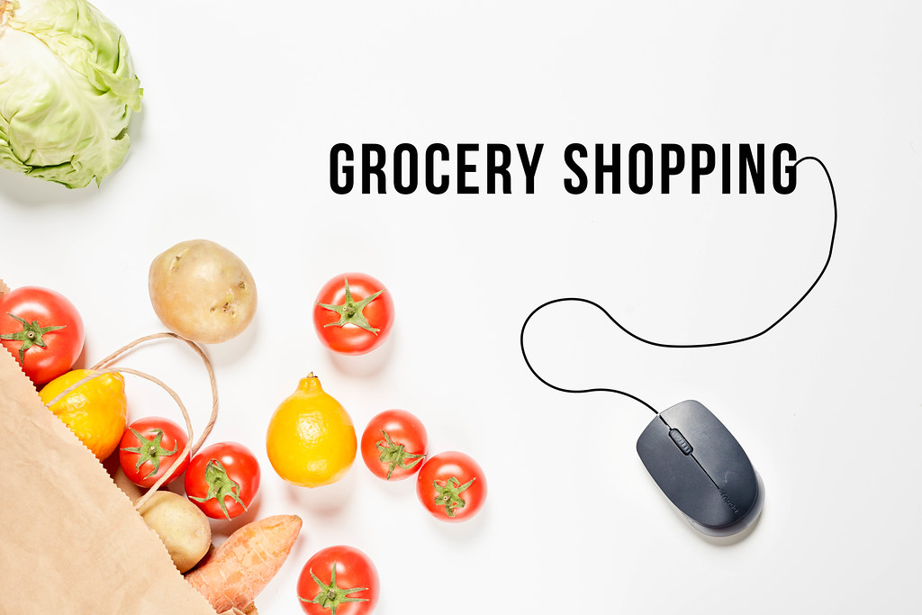 Grocery shopping concept with fresh vegetables and PC mouse