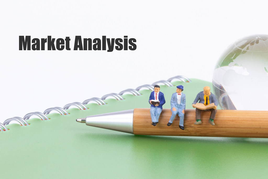 Group of people sitting on a pen with Market Analysis text
