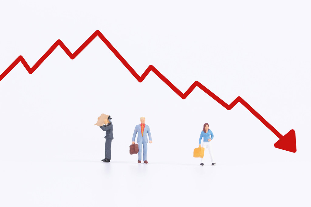 Group of people with red down graph