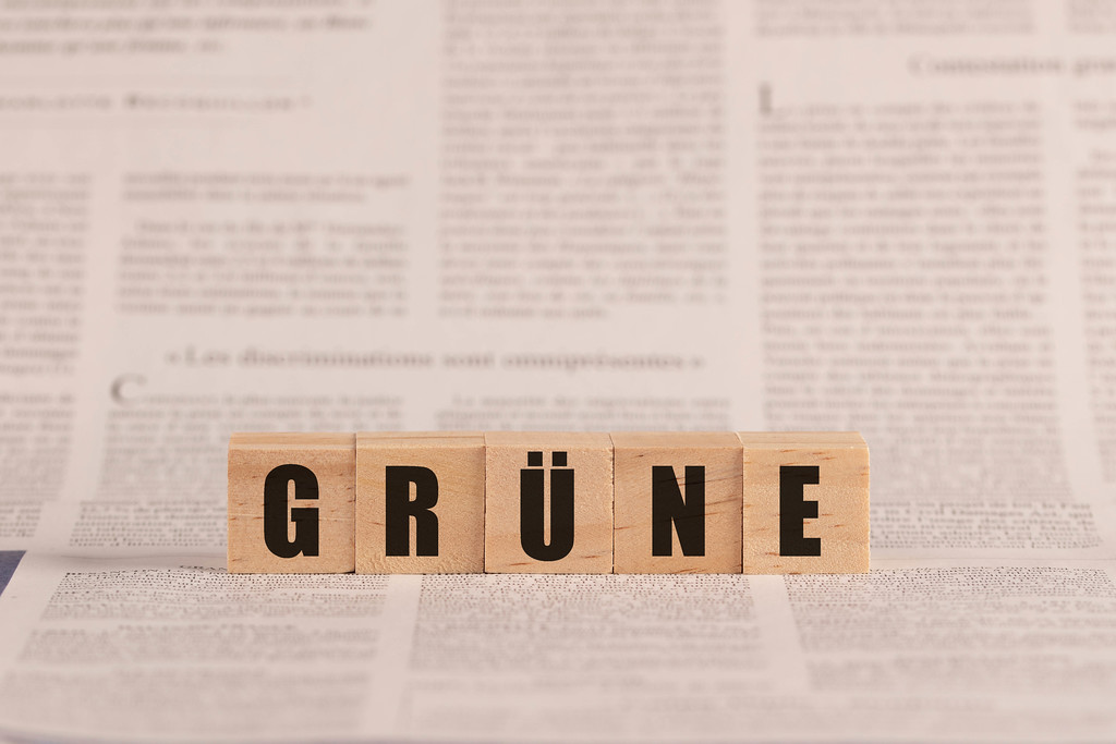 Grüne written with cubes on a newspaper