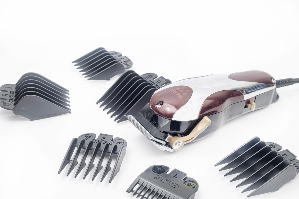 Haircut Trimmer and addons above white background