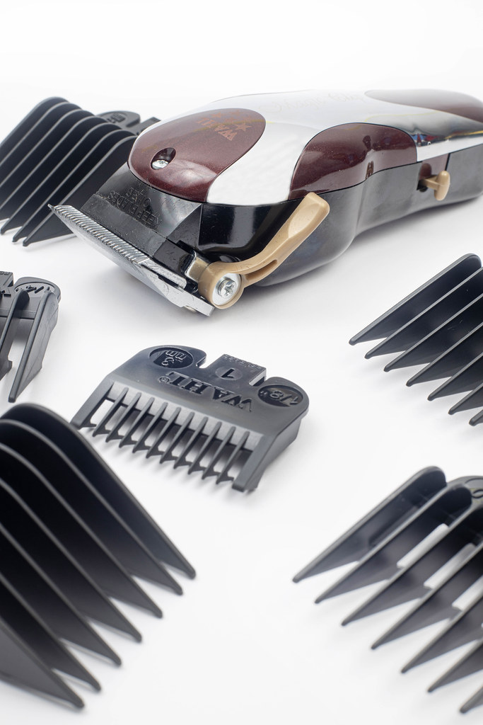 Haircut Trimmer with equipment above white background