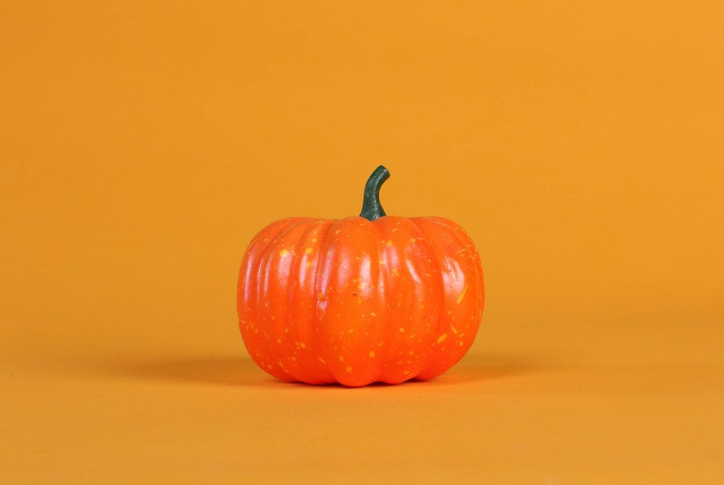 Halloween pumpkin decorations on a orange background