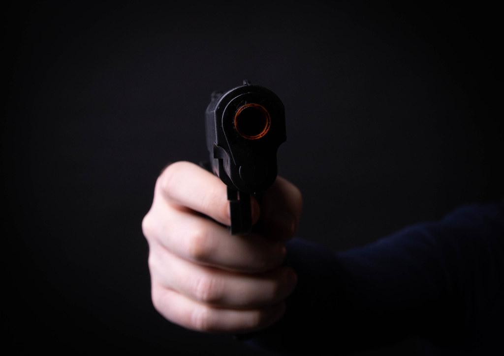 Hand holding a hand gun