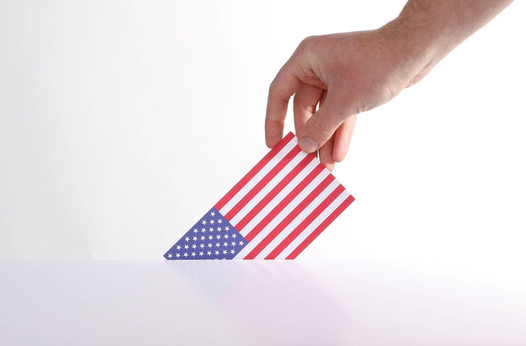 Hand holding American flag. USA election concept