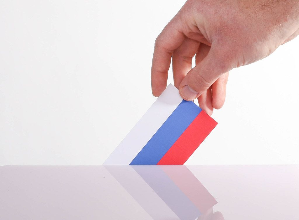 Hand holding Russian flag. Russian election concept