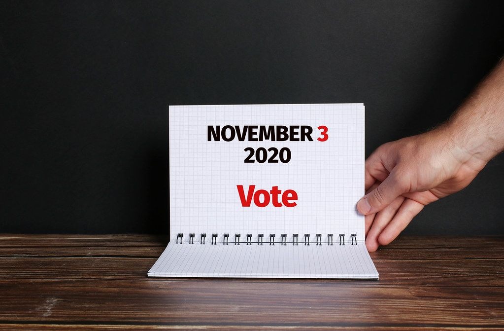 Hand opening notebook with USA Presidential Election date