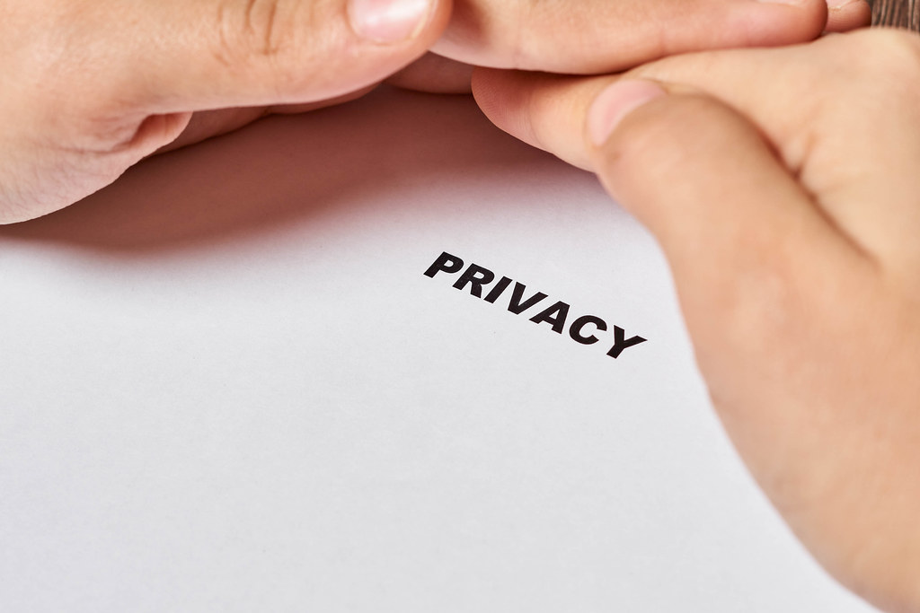 Hand protects privacy text. Privacy, Security of personal data, data protection concepts