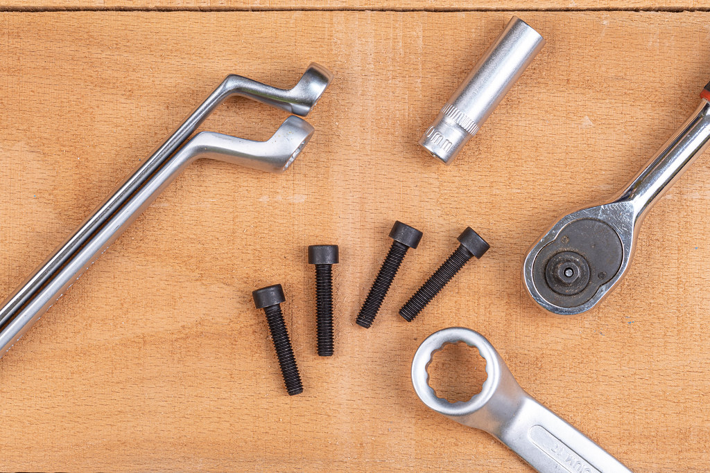 Hand tools with Inbus screws on the wooden table