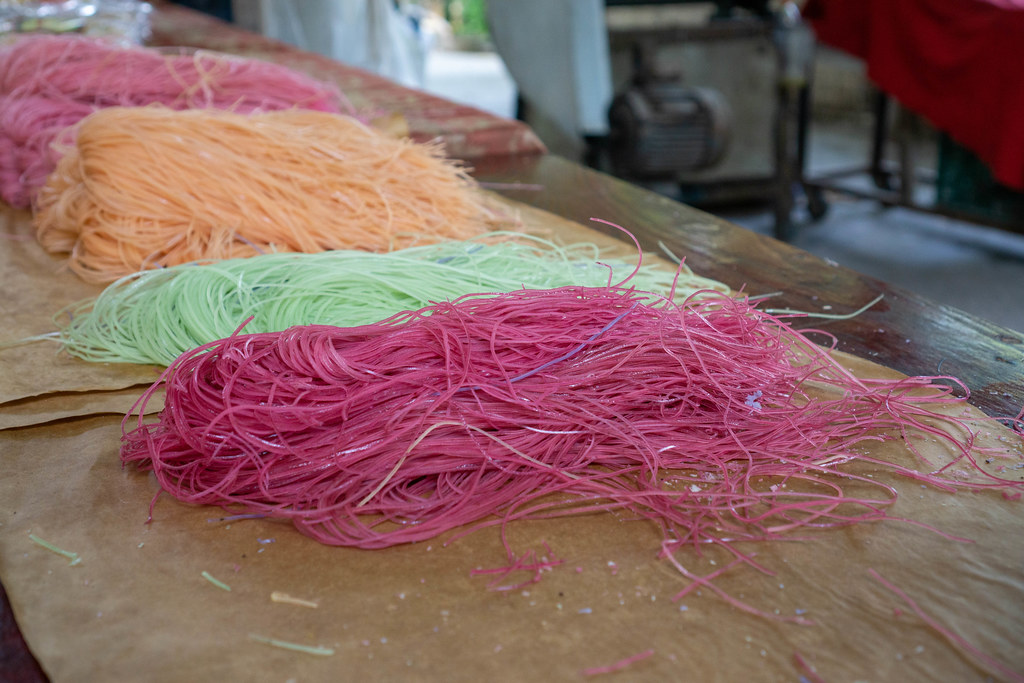 Handmade Noodles made from different Ingredients such as Sweet Potatoes on a Workshop Table at a Local Factory in Can Tho, Vietnam