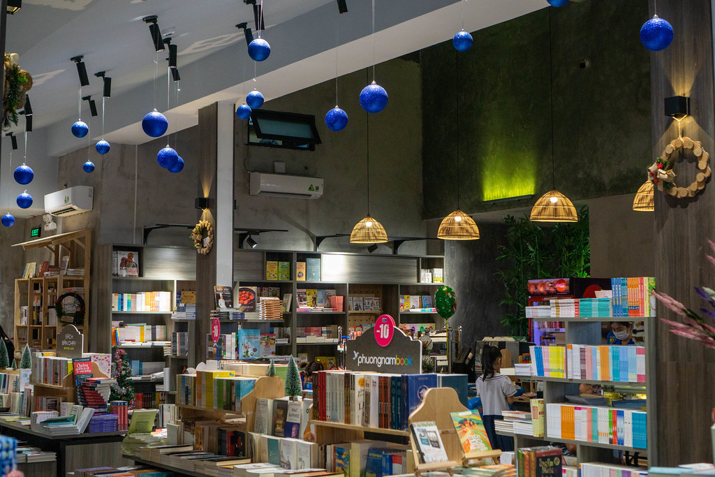 Hanging Christmas Ornaments and Hanging Ceiling Lamps in a Modern Bookstore with Cafe in Ho Chi Minh City, Vietnam