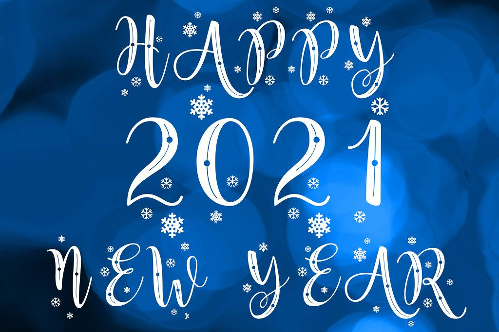 Happy 2021 new year on blue bokeh background